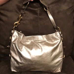 silver leather Coach purse with gold detailing